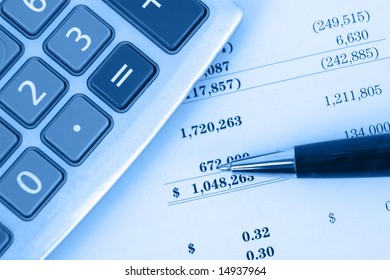 calculator on financial statement with blue overlay top view