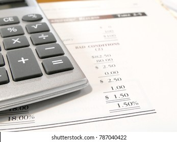calculator on the financial statement . The concept of economic outlook or business performance summary