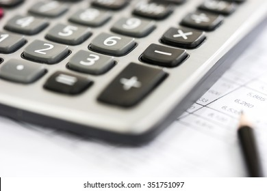 Calculator on the Financial table with pencil