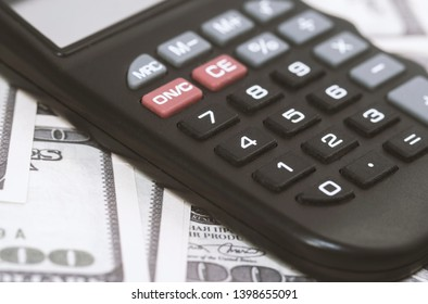Calculator on money banknote, finance and savings.Business concept