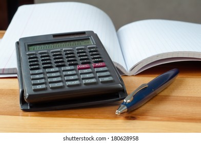 Calculator on a open notebook. Macro image with shallow depth of focus.