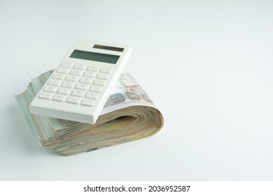 Calculator on stack of Thai baht bank note.Personal Loan concept.Mortgage loan concept.