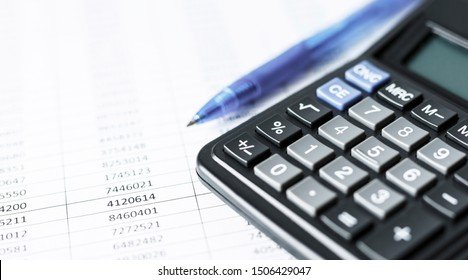 Calculator on white paper with numbers. Business and Finance accounting concept.