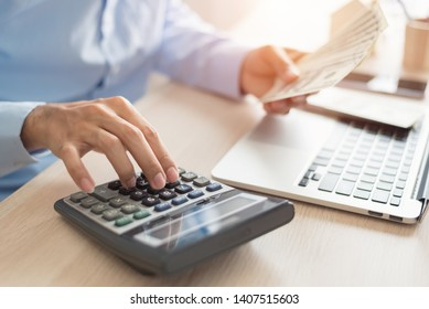 Calculator on wood table focus at on press button  the numbers finance accounting concept
