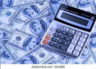 A calculator over some US dollar bill.