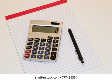 Calculator pad and pencil  on white background