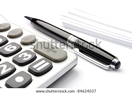 calculator, a pen and blank paper on the table