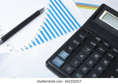 Calculator, pen and chart on office table. Home savings ,budget concept.