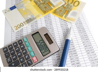Calculator, pen and euro note on the background of a sheet of paper with numbers