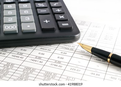 A calculator, pen, and financial statement.