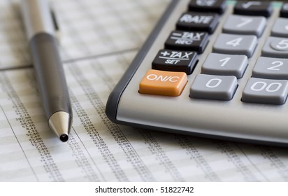 A calculator, pen, and financial statement. Selective focus.