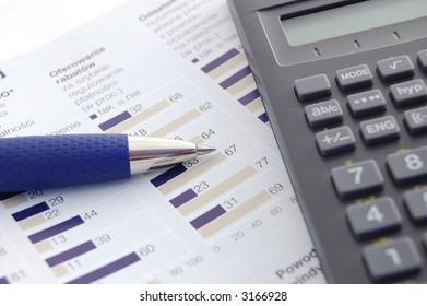 Calculator, pen and graph