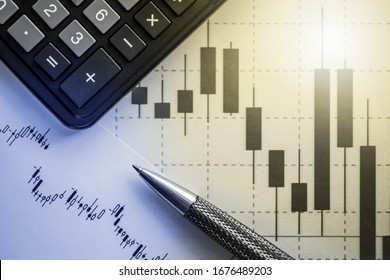 calculator, pen and graph - concept of financial data analysis, stock trading, growth and fall of stock indices and markets