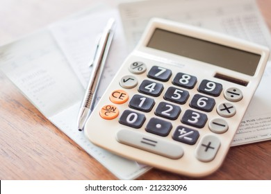 Calculator and pen on bank account passbook, stock photo