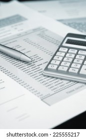 Calculator and Pen on Bank and credit card statements