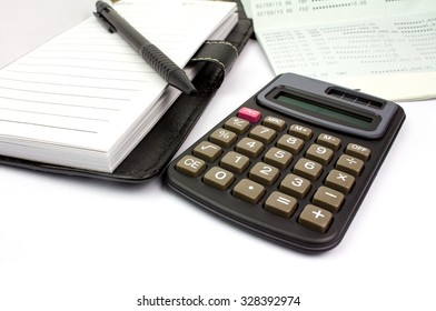 calculator and pen and passbook bank and notebook on white background, isolated