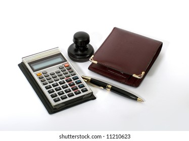 Calculator, Pen, Purse & Stamp. Isolated on white.