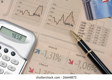 calculator and pencil  lie on the table with the data