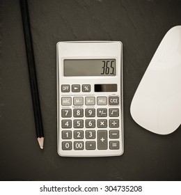 Calculator and pencil. Office equipment at workplace. Conceptual image of desk work, financial paperwork and business economy.