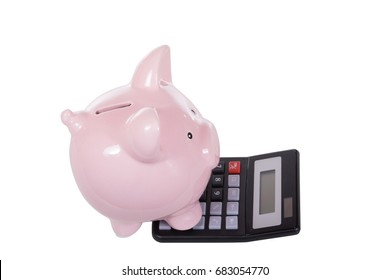 Calculator and piggy bank financial concept viewed side on high angle isolated on white showing the money slot and digital display with copy space above