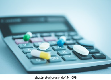 CALCULATOR WITH PILLS CONCEPT