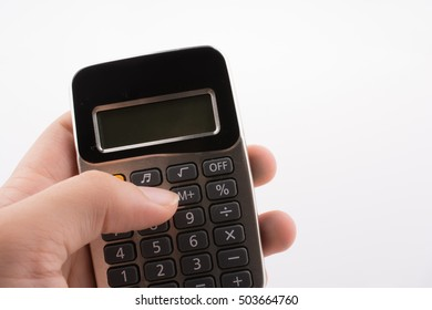 Calculator placed on white background