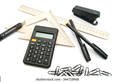 calculator, ruler and other stationery on white background