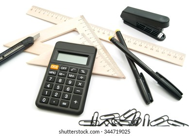 calculator, ruler and other stationery on white