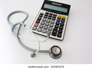 Calculator and Stethoscope (Medical fees concept)