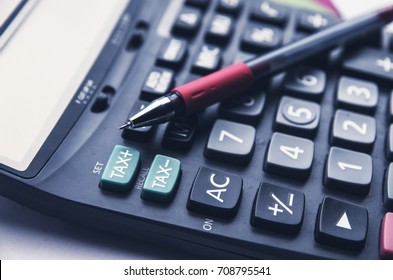 calculator and tax button and red pen