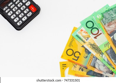 calculator and various australian money(AUD) isolated on white