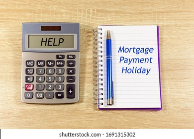 Calculator with the word 'Help' and Notepad with text 'Mortgage Payment Holiday'