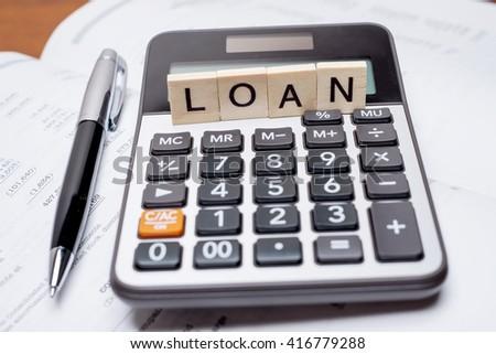 calculator word loan written wooden block stock photo (edit now