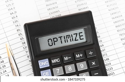 Calculator with the word OPTIMIZE on the display.