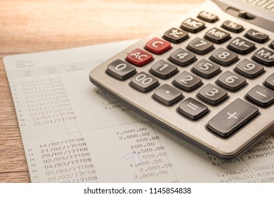 Calculatorl, bankbook Put on a wooden table.