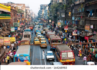 CALCUTTA, INDIA - JAN 18: Many private cars, yellow cabs and public buses on the street traffic jam on January 18, 2013 in Kolkata, India. Kolkata has a density of 814.80 vehicles per km road length