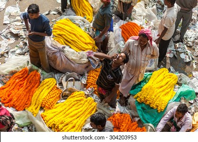 CALCUTTA, INDIA - NOVEMBER 20, 2014: Indian flower sellers. Flower market, Kolkata, India.