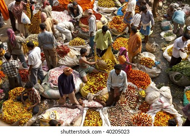 CALCUTTA - JANUARY 31: People trade flowers  underneath Howrah Bridge in Kolkata, India on January 31, 2007 in Calcutta, India. Flowers are used for giving pooja in temples and for decoration at weddings and funerals.