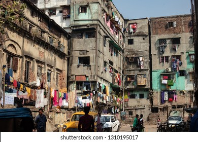 Calcutta (Kalkota) ,India -January 23,2019: Old town of Calcutta.Laundries are hanged on the wall of the old and dilapidated buildings.Some of the old buildings used for billboards also.
