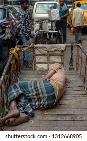 Calcutta (Kolkata), India- January 21, 2019: Streetlife and portraits from Calcutta.More than 5 million people live in the city.Some people earn a living by shaving, tailoring or driving rickshaws.