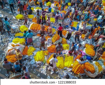 CALCUTTA, KOLKATA, INDIA - NOVEMBER 04, 2018: People buying and selling flowers and garlands at the flower market near mullick ghat on November 04, 2018 at Calcutta, West Bengal, India