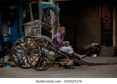 Calcutta (Kolkata ),India-January 21, 2019: Yellow cabs and hand-pulled rickshaws are very commonly used in Calcutta..Most of the Indian also uses colorful buses as a public transportation vehicle.