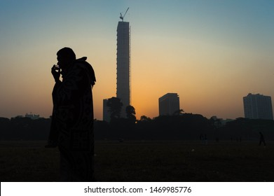 """Calcutta, West Bengal, India, 06/01/2018. Early morning scene of Calcutta, where building """"42"""" in backdrop.  It is currently the tallest building in India."""