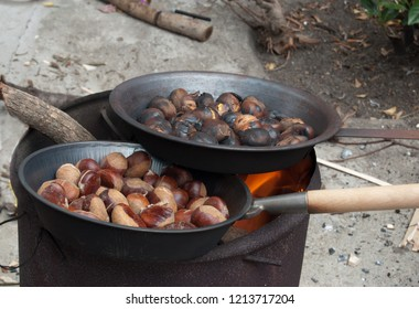 caldarroste. Roasted chestnuts . Chestnuts roasting in the flames of a fire
