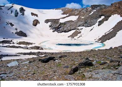 caldera glacial circus and caldera lagoon with snow in spring in sierra nevada, andalucia, spain