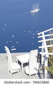 Caldera view with a cruise ship on sea from a terrace of Santorini Island, Greece