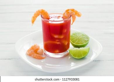 caldo camaron, Shrimp cocktail with lemon, mexican sea food in mexico