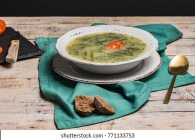 Caldo verde popular soup in Portuguese cuisine. traditional ingredients for caldo verde are potatoes, collard greens , olive oil and salt. Additionally garlic or onion may be added.
