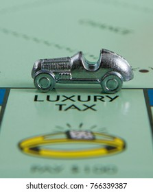 CALDWELL, IDAHO - APRIL 25 2017: Car up on the luxury tax spot from the game monopoly
