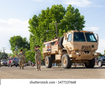 CALDWELL, IDAHO - JULY 4, 2019 - Large military transport truck carrying kids during the Caldwell, Idaho 4th of July parade